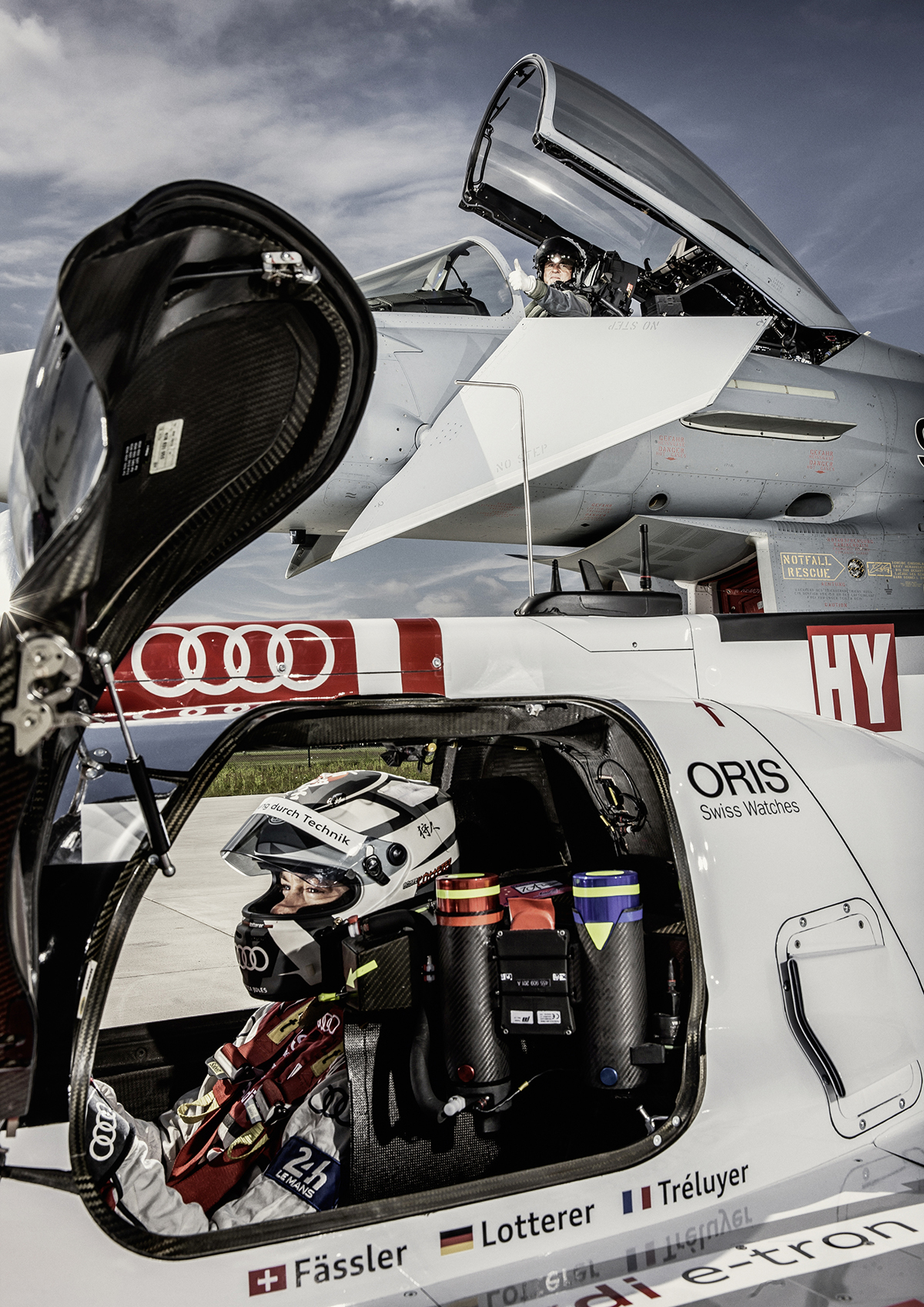 PASSION - FLIGHT CLUB Altitude differential – Krähenbühl's pilot seat is around five meters off the ground, while race driver Lotterer sits more or less directlyabove the asphalt.